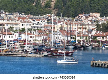 The small boat passing by the marina of Marmaris resort town (Turkey).