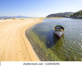 Small boat at Ponta das Canas beach - Florianopolis, Brazil