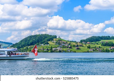 Small boat sailing on Lucerne lake, Switzerland.