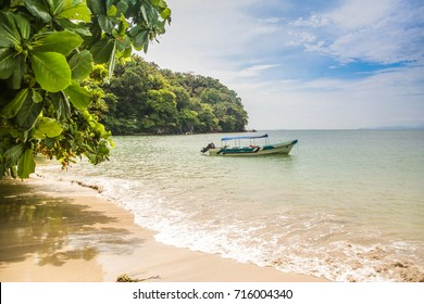 Small boat in secluded bay, Punta Sal and Janette Kawas National Park, Tela, Honduras.