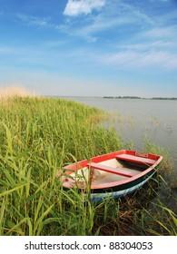 small boat at shore