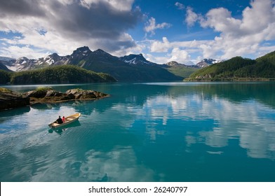 Small boat with two persons on Norwegian fjord