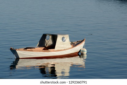 Small boat in the water with nobody for a tranquil scene