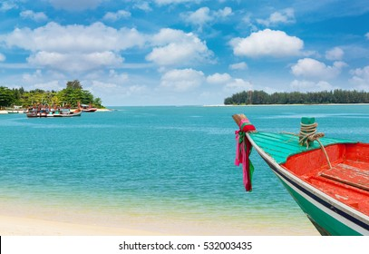 Small boat at white beach on summer in Thailand Asia