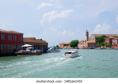 Small boats and buildings along the canals of Venice, Italy