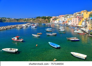 Small boats and colorful houses in Marina Corricella harbor on the island of Procida, bay of Naples, southern Italy