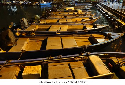 Small boats in a small fishing harbor at night