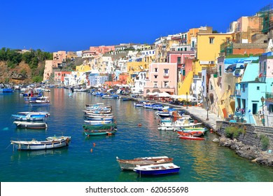 Small boats inside Marina Corricella harbor on the island of Procida, southern Italy