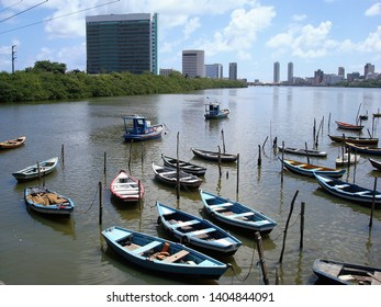 Small boats moored on the Capibaribe river in Recife, Brazil.