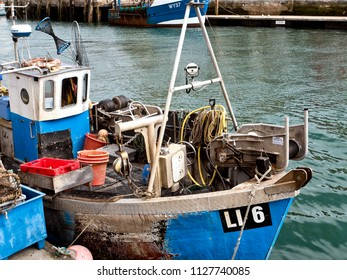 Small boats moored in Weymouth Harbor, Dorset, UK, June2018