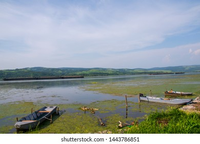 small boats on the Danube river  at the border between Romania and Serbia