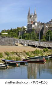 Small boats on the Maine river and the cathedral Saint Maurice of Angers on the background. Angers is a commune in the Maine-et-Loire department in western France about 300 km south-west of Paris
