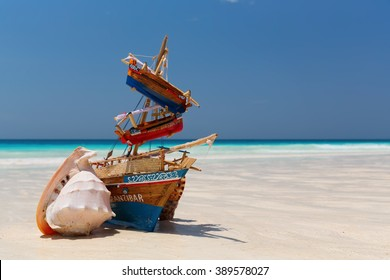 Small boats with a shell on the Nungwi beach, Zanzibar