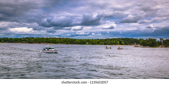 Small boats in the Swedish Archipelago during Midsummer, Sweden