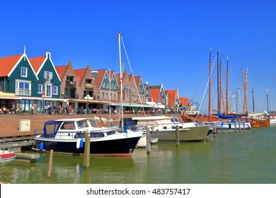 Small boats and traditional buildings in Volendam, Holland