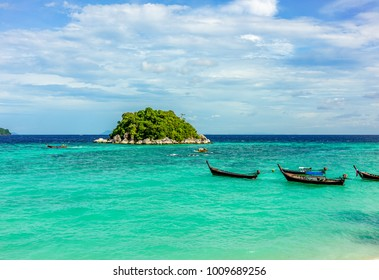 A small boats and tropical island with blur view of its trees a tropical islands on the horizon