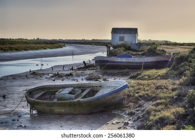 Small boats used for years by maricadores in salt marshes and mudflats