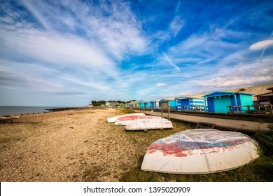 Small Boats and Wooden Beach Huts at the Beach in Whitstable, Kent, England