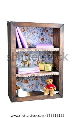 Small Bookshelf With Books And Cute Figurines Isolated On White Background