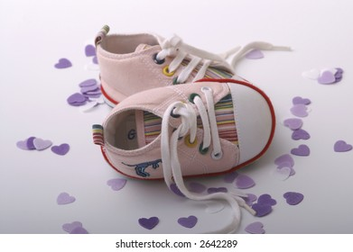 Small boots with small hearts around
