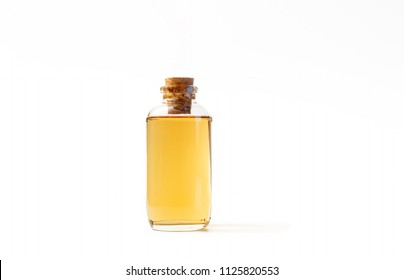 Small Bottle Filled With Homemade Drink, Isolated On White Background