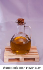 Small bottle of oil on a white background