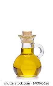 Small bottle of olive oil with cork stopper isolated in front of white background