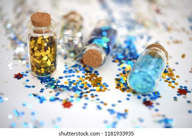 Small bottles with colorful glitter