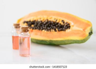 Small bottles of papaya extract with papaya fruit