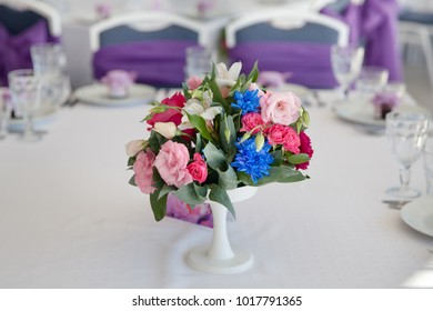 a small bouquet of flowers on the table