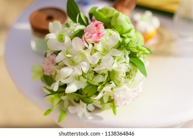 A Small Bouquet Of Fresh Flowers On The Table In The Afternoon