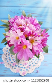 a small bouquet of fresh pink cosmos flowers -top view