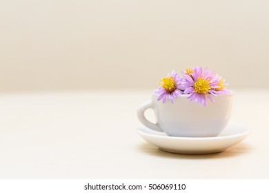 a small bowl of autumn flowers