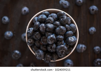 A small bowl of blueberries in natural light.