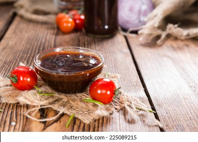 Small Bowl with homemade Barbeque Sauce on wood
