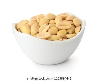 Small bowl of roasted salted peanuts isolated on white
