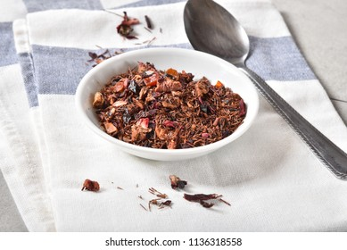 Small bowl of rooibos tea with dried kiwi fruit and strawberry bits