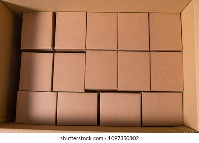 Lot of small boxes inside of large container