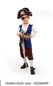 Small boy 5-6 years old poses in the pirate costume