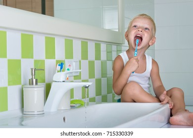 Small boy brushing teeth in the bathroom.The beginning of a new day