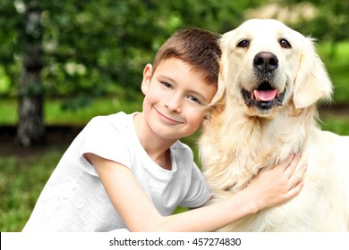 Small boy and cute dog in park
