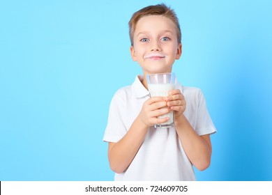 small boy drink a glass of milk with different emotions on blue background
