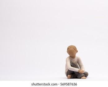 small boy figure on ground