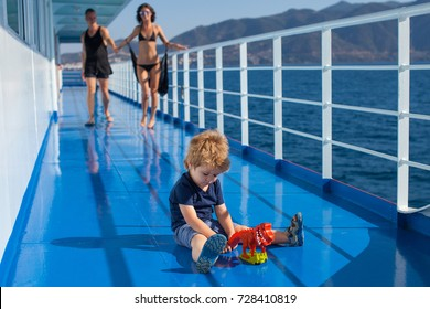 Small boy playing. Little boy plays. Family concept. Couple in love. Man and woman walking boat. Lifestyle. Vacation, tourism, travel, adventure. Summer time. Dream. Love story. Family photo. Child.