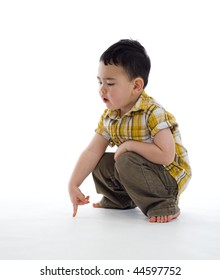 small boy pointing at something, isolated on white