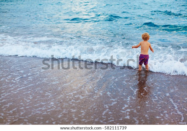 Small boy and sea