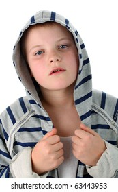 Small boy in sportswear tired after match isolated on white