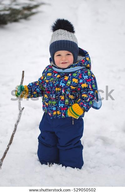 Small boy in winter snow.