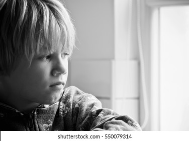 A small boy with a worried expression on his face depicting being a victim of bullying