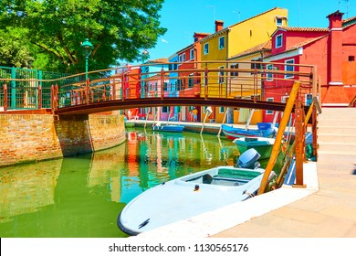 Small bridge and colorful houses by canal in Burano, Venice, Italy